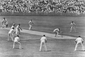 Bill Woodfull of Australia ducks to avoid a rising ball from Harold Larwood of England during the Fourth Test match at Brisbane on the infamous 'Bodyline' Tour of Australia.