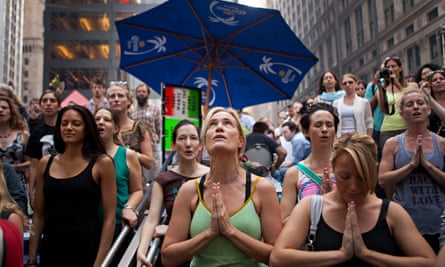 Rose Caulfield, center, from Hoboken, N.J., participates in a public session of yoga, led by yoga instructor Seane Corne, in collaboration with the Occupy Wall Street protests in Zuccotti Park, on Monday, Oct. 10, 2011, in New York