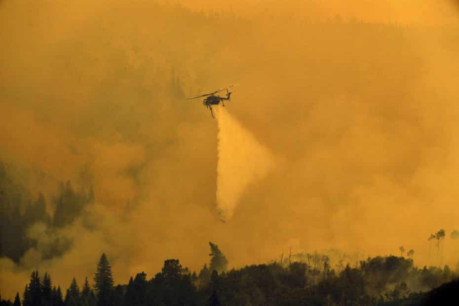 A helicopter drops water on the Grizzly Creek fire on the east end of Glenwood Canyon near Glenwood Springs, Colorado, on 17 August.