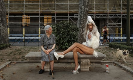 2016 AP YEAR END PHOTOS - A woman looks across as a gay parade participant poses for pictures during Gay Pride parade in Madrid, Spain, July 2, 2016. (AP Photo/Daniel Ochoa de Olza, File)