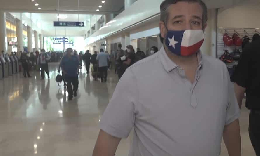 Ted Cruz sports a Texas flag face mask – at Cancun airport in Mexico.