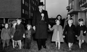 British prime minister Clement Attlee in Priory Court, London, with a group of children in October 1951