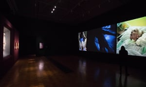 Bill Viola's Nantes Triptych, 1992, right, opposite Michelangelo's Taddei Tondo at the Royal Academy.