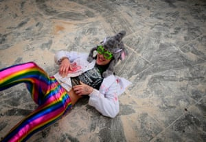 A reveller in fancy dress is floored after taking a direct hit.