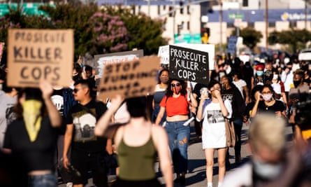 Hundreds of people protest following the death of George Floyd, in Los Angeles, California.