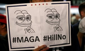 A man holds a Pepe the Frog sign at a Trump campaign rally in Albuquerque, New Mexico on 30 October 2016.