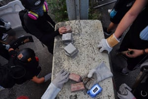 Kowloon Bay, Hong Kong: Protesters pick up bricks to be used as projectiles as they clash with riot police