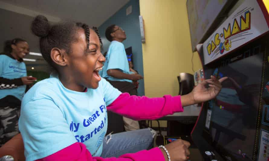 ayla plays Pac-Man at the unveiling of Aaron's $ 20,000 makeover at the Berkshire Partners Teen Center Blue Hill Boys and Girls Club in Boston