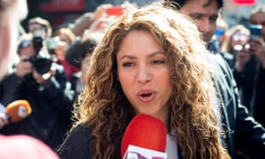 Shakira speaks to reporters as she leaves court in Madrid, Spain on 27 March.