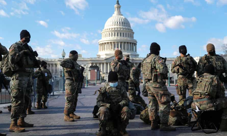 National guard troops gather in front of the US Capitol one day ahead of Joe Biden's inauguration in Washington, 19 January 2021.