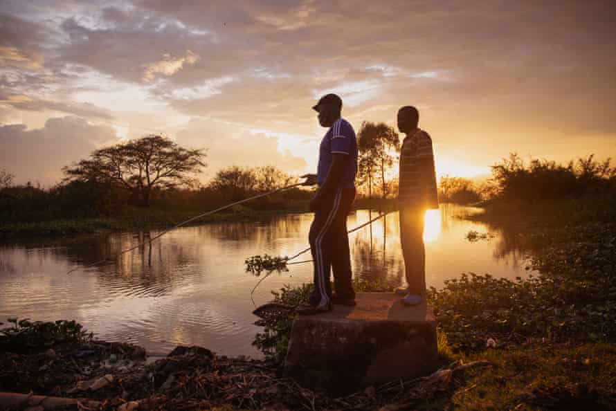 Nightclub doorman Erick Ochieng, left, and and mechanic Patrick Obondo try to catch fish to feed their families.