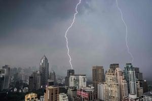 Bangkok, ThailandLightning bolts strike buildings during a thunderstorm in Bangkok