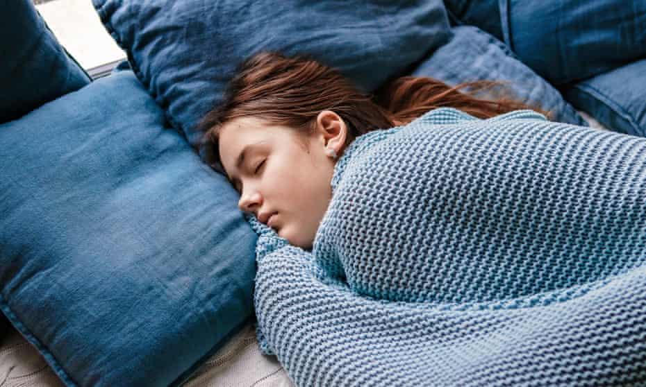 Teenage girl asleep in bed