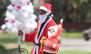 A Santa Claus sells Christmas decorations in Harare.