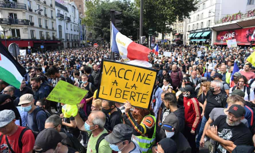 Demonstrators in Paris protest on Saturday against the French government's plans to introduce a mandatory Covid health pass for access to many public venues