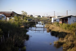 Scenes from the disappearing bayou in Isle de Jean Charles, where the tribe has been awarded $52 million to resettle on higher ground.