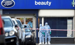 Police forensic officers work near the site where Suddesh Amman was shot dead by armed officers in Streatham, south London.