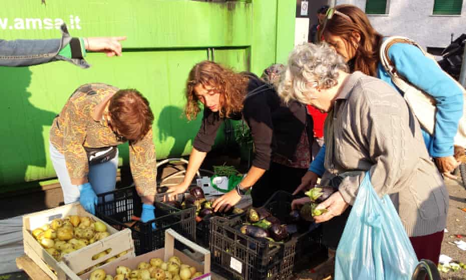 Volunteers collect food from market in Milan