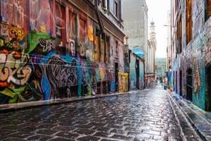 Hosier Lane in Melbourne's CBD is quiet and deserted under lockdown.