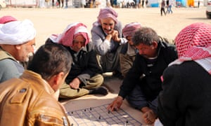 Yazidi refugees play chess at a refugee camp in Duhok