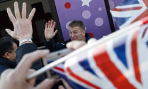 British astronaut Tim Peake waves to his relatives near a bus before the launch