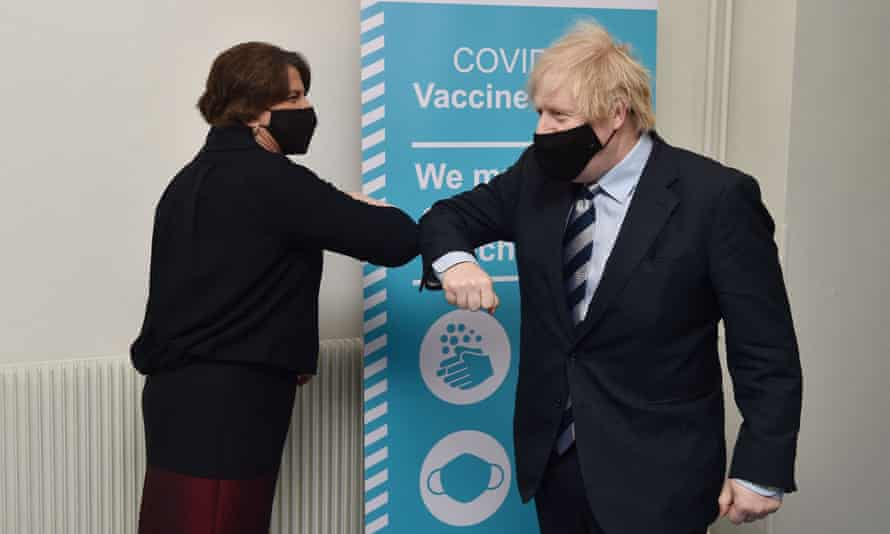 Boris Johnson (R) greets Northern Ireland First Minister Arlene Foster as they visit a Covid-19 vaccination centre  in Enniskillen, Northern Ireland