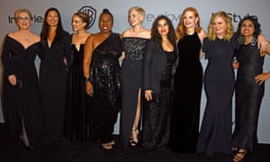 Actors and activists … Meryl Streep, Ai-jen Poo, Natalie Portman, Tarana Burke, Michelle Williams, America Ferrera, Jessica Chastain, Amy Poehler and Saru Jayaraman at the Golden Globes.