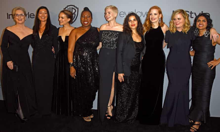 Actors and activists … Meryl Streep, Ai-jen Poo, Natalie Portman, Tarana Burke, Michelle Williams, America Ferrera, Jessica Chastain, Amy Poehler and Saru Jayaraman at the Golden Globes.