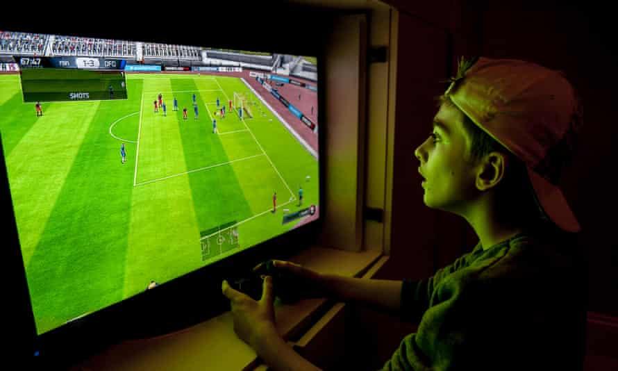 A boy playing Fifa