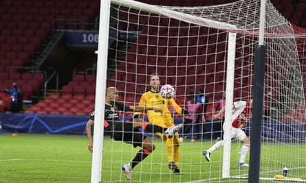 Fabinho clears off the line to deny Dusan Tadic and seal Liverpool's Champions League win at Ajax.