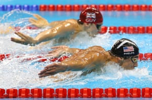 Michael Phelps leads James Guy of Great Britain.