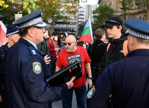 Raul Bassi, organiser of the Sydney Black Lives Matter rally, speaks with police officers