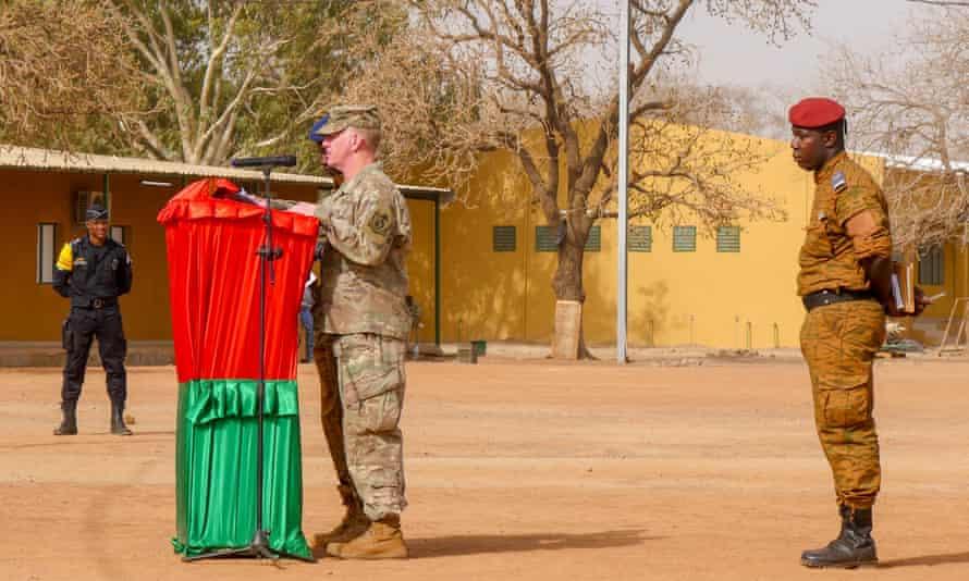 Maj Gen Marcus Hicks addresses Burkina Faso's president in a military camp just outside Ouagadougou, Burkina Faso