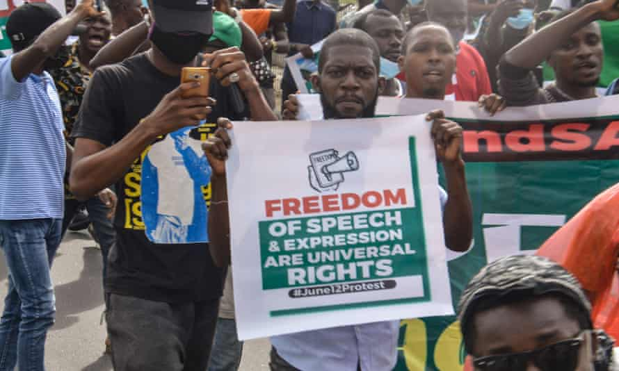 A protester holds a banner during a protest in Lagos last month.