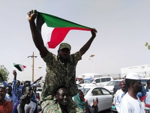 Jubilant Sudanese people march towards military headquarters
