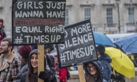 Campaigners protest at the 2018 Time's Up Women's March in London.