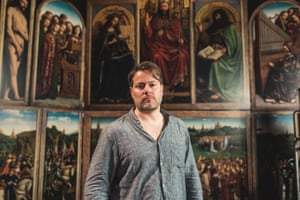 'You have to be international and local at the same time' … theatre director Milo Rau before a reproduction of the Ghent Altarpiece.
