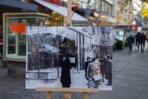 A photo showing Nazi-destroyed Jewish shops in Berlin at the same location 80 years later on.