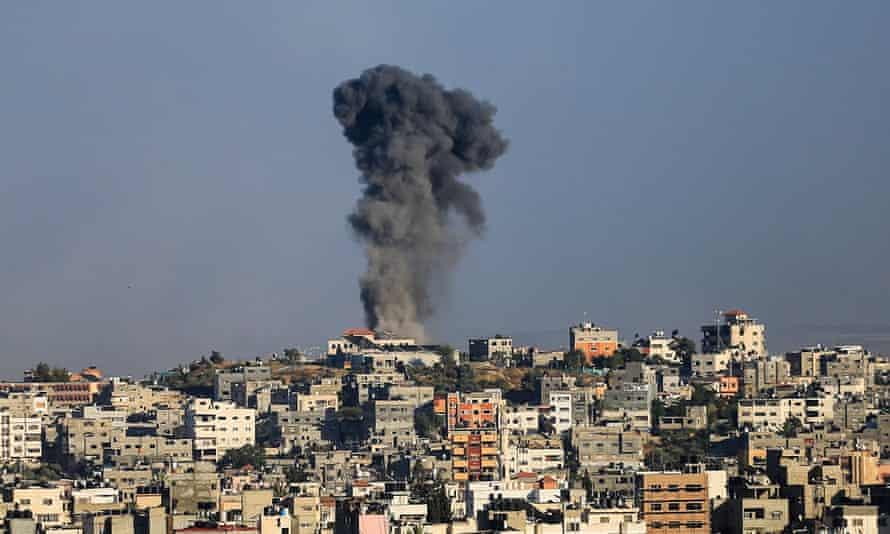A plume of black smoke rises from a residential area. Gaza Strip, Palestinian Territory - 18 May 2021