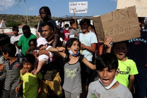 Asylum seekers protest against the new camp at Kara Tepe.