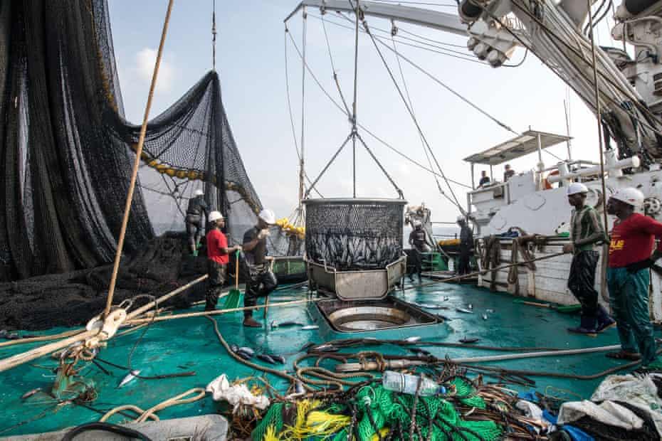 Fishermen aboard the Oriental Kim haul in the morning's catch