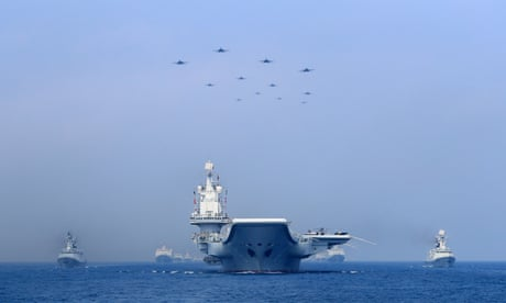 Warships and fighter jets of the Chinese People's Liberation Army (PLA) navy take part in a military display in the South China Sea.