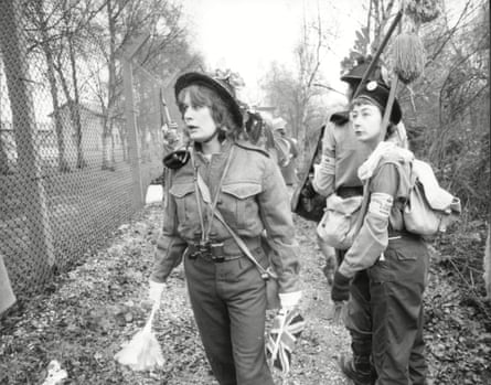 Women dressed as soldiers patrol the exterior fences in November 1982.