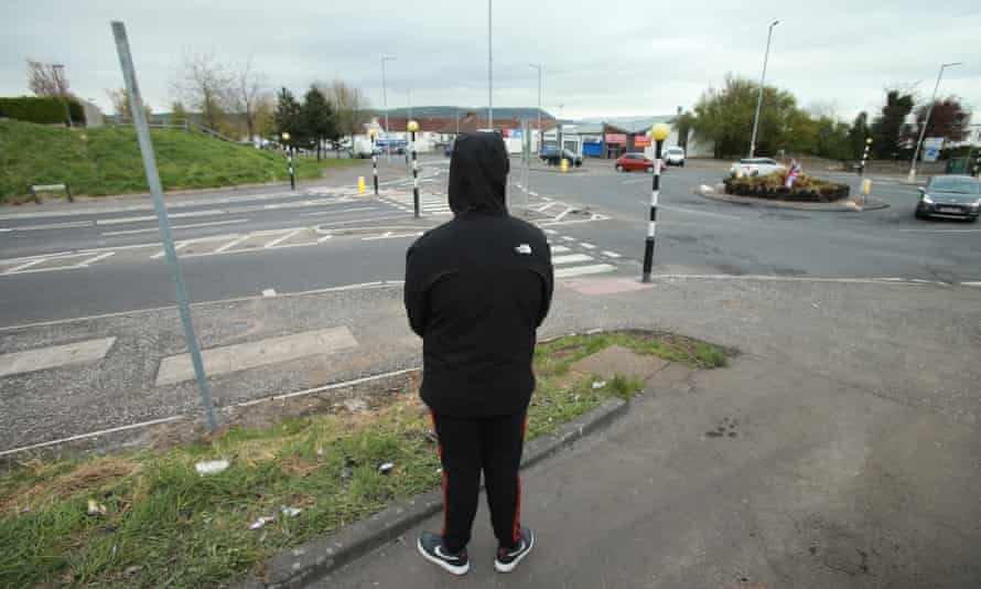 A young Protestant named Bob watches over a roundabout in Newtownabbey.