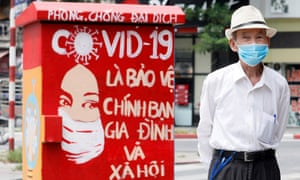 An elderly man walks past an electrical box painted with a Covid-19 theme to promote hand washing and wearing face masks as preventive measures, and to pay tribute to the health workers during the coronavirus disease pandemic. in Hanoi, Vietnam, 7 June.