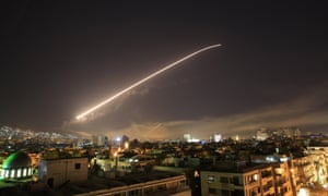 The Damascus sky lights up with missile fire as the US launches an attack on Syria.