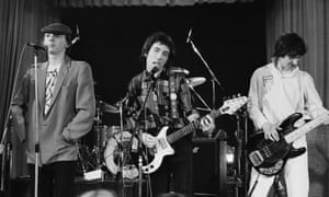 Pete Shelley, centre, with Howard Devoto, left, and Steve Diggle performing with Buzzcocks at the Lesser Free Trade Hall, Manchester, in the late 70s.