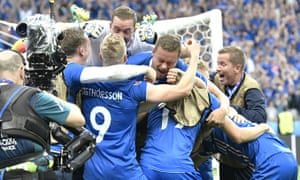 Iceland players celebrate a goal by Iceland's Arnor Ingvi Traustason