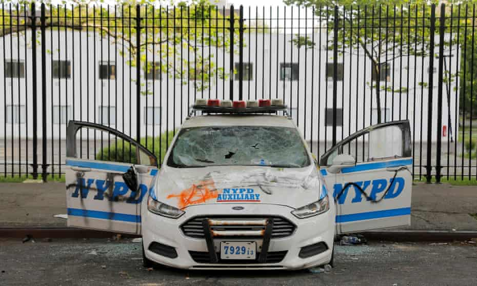 A vandalized New York police vehicle is seen the morning after a protest in Brooklyn on Saturday.