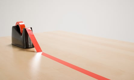 Red tape on a desk
